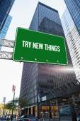 Try new things against skyscraper in city — Stock Photo