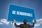 Word be remarkable and gesturing businessman — Stock Photo