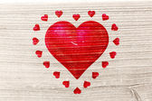 Composite image of red love hearts — Stock Photo