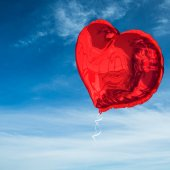 Composite image of red heart balloon — ストック写真