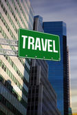 Travel against low angle view of skyscrapers — Stock Photo