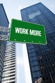 Work more against low angle view of skyscrapers — Stock Photo