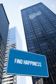 Find happiness against low angle view of skyscrapers — Stock Photo