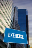 Exercise against low angle view of skyscrapers — Stock Photo