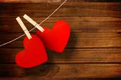 Composite image of hearts hanging on line — Stock Photo