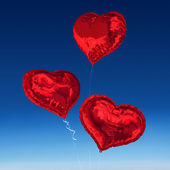 Composite image of love heart balloons — Stock Photo