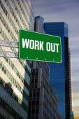 Work out against low angle view of skyscrapers — Stock Photo
