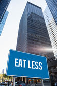Eat less against skyscraper in city — Stock Photo
