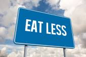 Eat less against blue sky with white clouds — Stock Photo