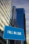 Fall in love against low angle view of skyscrapers — Stock Photo