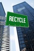 Recycle against low angle view of skyscrapers — Stock Photo
