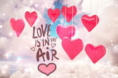 Composite image of love is in the air — Stock Photo