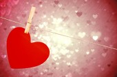 Composite image of heart hanging on line — Stock Photo