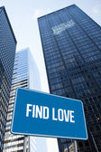Find love against low angle view of skyscrapers — Stock Photo