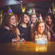 Friends celebrating a birthday together — Stock Photo #65279719