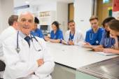 Medical professor smiling at the camera during class — Stock Photo