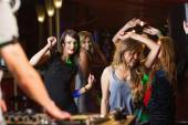 Happy friends dancing by the dj booth — Stock Photo