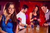 Happy friends on a night out together — Stock Photo
