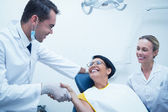 Dentist shaking hands — Stock Photo