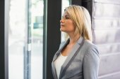 Blonde businesswoman waiting for someone — Stock Photo
