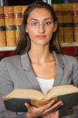 Lawyer reading book in the law library — Stock Photo