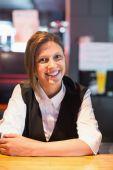 Pretty barmaid smiling at camera — Stock Photo