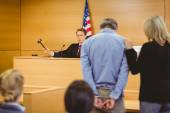 Judge about to bang gavel on sounding block — Stock Photo