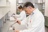 Pharmacist using press to make pills — Stock Photo