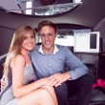 Happy couple smiling in limousine — Stock Photo #65282679