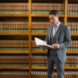 Lawyer reading book in the law library — Stock Photo #65283247