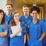 Medical students smiling at the camera — Stock Photo #65283859