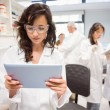 Science student looking at tablet pc — Stock Photo #65284283
