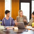 Female with students and teacher in library — Stock Photo #65284543