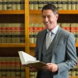 Lawyer holding book in the law library — Stock Photo #65286001