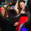 Happy friends dancing by the dj booth — Stock Photo #65286399