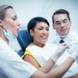 Dentist with assistant showing woman — Stock Photo #65286849