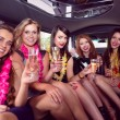 Happy friends drinking champagne in limousine — Stock Photo #65287575