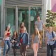 Happy students walking and smliling outside — Stock Photo #65288079