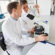 Young scientists working together — Stock Photo #65289345