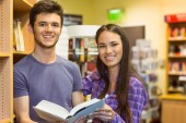 Smiling friends student holding textbook — Stock Photo