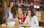 Portrait of three classmates working together — Stock Photo