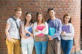 Happy students smiling at camera — Stock Photo