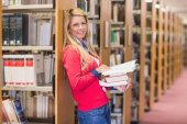 Mature student standing in library — Stock Photo