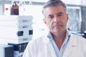 Unsmiling scientist wearing lab coat — Stock Photo