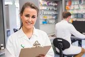 Pharmacy intern smiling at camera — Stock Photo