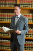 Lawyer holding book in the law library — Stock Photo