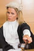 Stern judge pointing her hammer — Stock Photo
