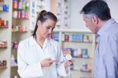 Trainee and her customer talking about medication — Stock Photo