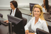 Smiling businesswoman working in computer room — Stock Photo