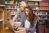 Blond mature student helping her classmate — Stock Photo